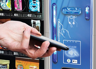 Snack vending machine accepts contactless payments, e-wallet payments, credit cards, debit cards, bills and coins.
