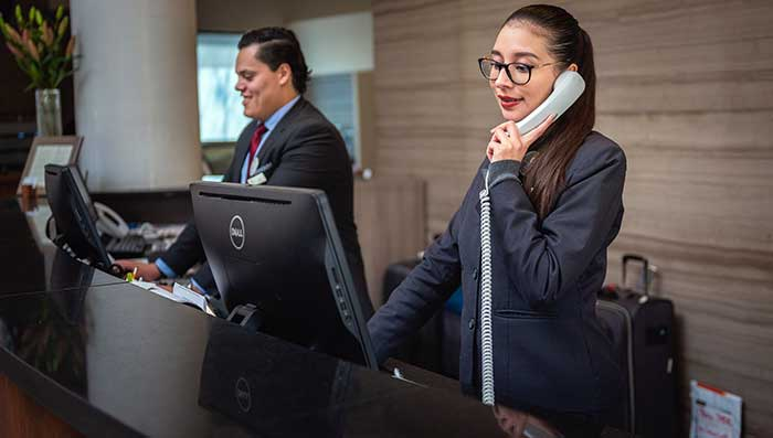 Receptionists at a hotel front desk